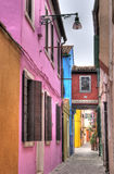 Burano alley. Colorful alley in Burano, Italy royalty free stock photo