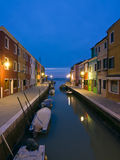 Burano canal reflections at dusk Stock Images