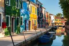 Burano canal street. VENICE, ITALY - SEPTEMBER 20, 2012: Canal street with boats and colored houses in Venetian Burano island on 20 of September 2012, Venice Stock Images