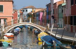 Burano Canal, Venice. Typical canal scene in Burano, and Island in the Venetian lagoon famous for it's colourful houses Stock Photo