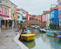 Burano colorful houses during rain stock images