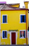Burano. Colorful yellow and blue house in the old town of Burano, a little island  in Venice lagoon, Italy Stock Photo