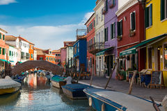 Burano colours. The small town of Burano near Venice consists of colorful houses and canals with boats Royalty Free Stock Photo