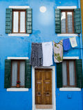 Burano colours. The small town of Burano near Venice consists of colorful houses and canals with boats Stock Images