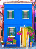 Burano house. Entrance of a colorful apartment building in burano venice italy Stock Images