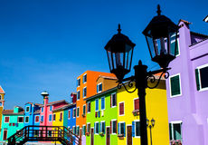 Burano island canal, colorful houses Stock Images