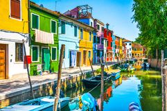 Burano island canal, colorful houses and boats,Venice, Italy. Burano island canal, colorful houses and boats, Venice Italy Europe Royalty Free Stock Image