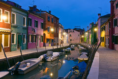 Burano island canal reflections at dusk stock photo