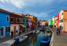 Burano island canal, small colored houses and the boats Royalty Free Stock Photography