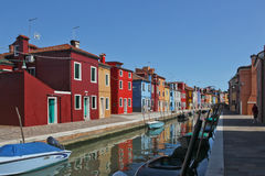 Burano. Island near Venice, bright houses, channel, Italy, summer, boats on the channel Royalty Free Stock Images