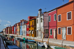 Burano. Island near Venice, bright houses, channel, Italy, summer, boats on the channel Royalty Free Stock Photo