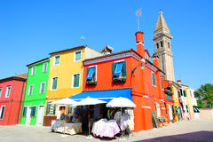 Burano island square with multicolored houses Stock Photos