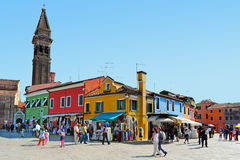Burano Island in the Venetian lagoon Italy. BURANO ISLAND, ITALY - MAY 01 2011:Visitors in Burano Island in the Venetian lagoon Italy.Burano Island is known for Stock Photography