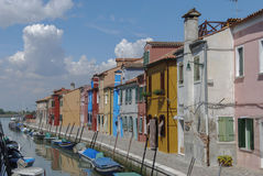 BURANO - ITALY, APRIL 18, 2009: Panoramic view of colorful buildings and boats in front of a canal at Burano Stock Image
