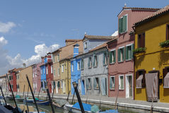 BURANO - ITALY, APRIL 18, 2009: Panoramic view of colorful buildings and boats in front of a canal at Burano Stock Photography