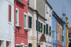 BURANO, ITALY - APRIL 18, 2009: Street with colorful buildings in Burano island, a gracious little town full of canals, near Venic Royalty Free Stock Image