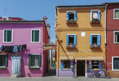 BURANO, ITALY - APRIL 18, 2009: Street with colorful buildings in Burano island, a gracious little town full of canals, near Venic Royalty Free Stock Photo