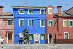 BURANO, ITALY - APRIL 18, 2009: Street with colorful buildings in Burano island, a gracious little town full of canals, near Venic Royalty Free Stock Photography