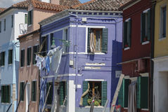 BURANO, ITALY - APRIL 18, 2009: Street with colorful buildings in Burano island, a gracious little town full of canals, near Venic Stock Photos