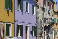 BURANO, ITALY - APRIL 18, 2009: Street with colorful buildings in Burano island, a gracious little town full of canals, near Venic Royalty Free Stock Photos