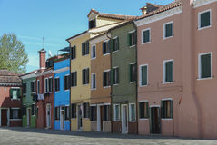BURANO, ITALY - APRIL 18, 2009: Street with colorful buildings in Burano island, a gracious little town full of canals, near Venic Stock Photo