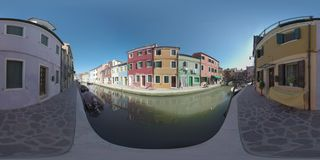 360 VR Burano island scene with canal and brightly painted houses, Italy stock video