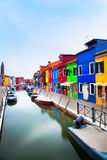 Houses beside canal Burano. Boats and colorful houses beside the canal on Burano Island in the Venice Lagoon, Italy stock image