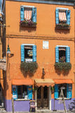 Burano, Italy. Colorful house with nice windows on the beautiful Island of Burano in Italy, july 2015 Royalty Free Stock Photography