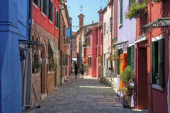 Burano, Italy. Colorful houses in a street on the beautiful Island of Burano in Italy, july 2015 Royalty Free Stock Photos