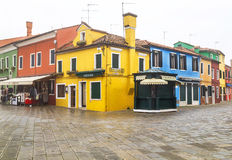 Burano, Italy – December  22, 2015: Scenic view of square with colored houses in the Burano island. Stock Photos