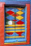 Burano, Italy. July 2015. Close up details of a the window of a multicolored house (Casa di Bepi) with abstract shapes and designs in Burano, one of the Stock Images