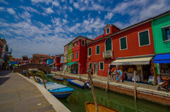 BURANO, ITALY - JUNE 14, 2015: Lovely nice bridge in the middle of water canals in Burano, color houses on the sides Stock Image