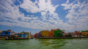 BURANO, ITALY - JUNE 14, 2015: Nice view of Burano from the sea, color buildings with nice white and blue sky Stock Images