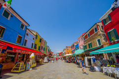 BURANO, ITALY - JUNE 14, 2015: Shop street at Burano, pinturesque neighborhood with colorfull houses on the sides Royalty Free Stock Image