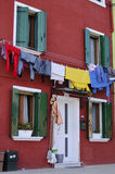 Burano (Italy). Laundry hung to dry outside a colorful home in Burano, Italy Stock Images