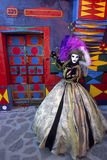 Burano's rainbow kiss. Venice Carnival 2005 - Burano fishing village - colored house - Italy Royalty Free Stock Photos