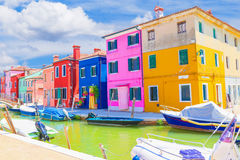 Burano street with fantastic sky in background Royalty Free Stock Images