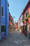 Burano street, Italy. Colorful houses in a street on the beautiful Island of Burano in Italy, july 2015 Royalty Free Stock Photography