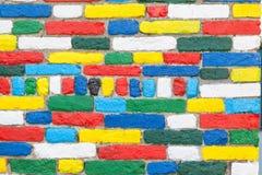 Burano, Venezia, Italia Muro di mattoni esteriore brillantemente dipinto Fotografie Stock Libere da Diritti