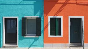 Burano, Venezia, Italy. Details of the windows and doors of the colorful houses in Burano island. Spring time royalty free stock photos