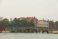 The Burano of Venice in fog. Stock Photos