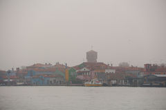 The Burano of Venice in fog. Stock Photo