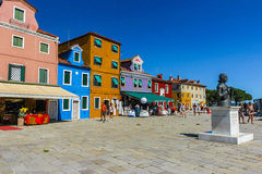 Burano, Venice island, colorful town in Italy. BURANO, VENICE, ITALY - JULY 16: People are walking in Burano on July 16, 2012 in Venice. Burano is an island in Stock Photo