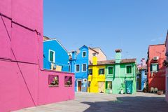 Burano, Venice, Italy. Cluster of brightly colored  cottages  in Stock Photos