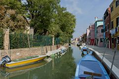 Burano water street - canal with boats Royalty Free Stock Image