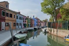 Burano water street - canal with boats Royalty Free Stock Images