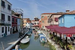 Burano water street - canal with boats Stock Images