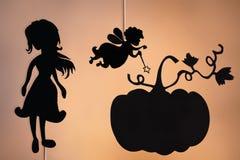 Burattini dell'ombra della fata madrina, di Cenerentola e della zucca Fotografie Stock