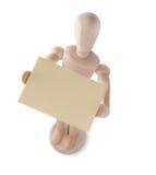 Burattino di legno che alza carta da lettere Fotografia Stock Libera da Diritti