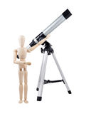 Burattino di legno con il telescopio Immagini Stock Libere da Diritti